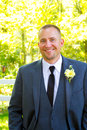 Handsome groom portrait on wedding day male his poses for a before the ceremony looking formal and Royalty Free Stock Photos