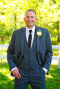 Handsome groom portrait on wedding day male his poses for a before the ceremony looking formal and Royalty Free Stock Photo