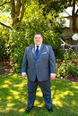 Handsome groom portraits of a on his wedding day while waiting for his bride at a park outdoors in oregon before the ceremony Royalty Free Stock Photo