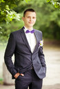 Handsome groom at wedding tuxedo smiling and waiting for bride Royalty Free Stock Photo