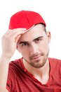 Handsome guy in baseball cap smiling at camera isolated on white Stock Photos