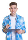 Handsome guy in a checked shirt with tablet computer on an isolated white background for cut out Royalty Free Stock Photography