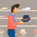 Handsome guy is doing shopping interested in a new fashion hat Stock Image