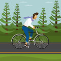 Handsome guy in the park rides a bicycle Stock Images