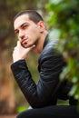 Handsome guy sitting thinking. Short hair Royalty Free Stock Photo