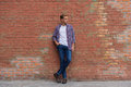 Handsome guy standing near brick wall Royalty Free Stock Photo