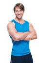 Handsome happy sportsman in blue shirt portrait of posing over white background Royalty Free Stock Images