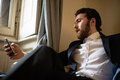 Handsome hipster elegant man on the cellphone bearded Royalty Free Stock Photo
