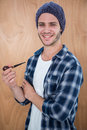Handsome hipster smocking a pipe Royalty Free Stock Photo