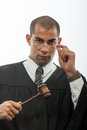 Handsome hispanic judge holding gavel Stock Images