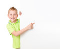 Handsome kid boy pointing to blank advertisement banner isolated Royalty Free Stock Photos