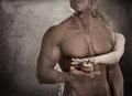 Handsome male body. Couple holding apple in hands. Concept Adam Royalty Free Stock Photo