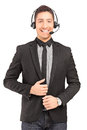A handsome male customer service operator wearing a headphones a Royalty Free Stock Images