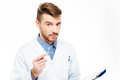 Handsome male doctor looking at camera isolated on a white background Royalty Free Stock Image