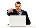 Handsome male executive pointing at you Royalty Free Stock Photography