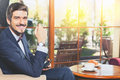 Handsome male has a french breakfast at cafe restaurant Royalty Free Stock Photo
