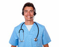 Handsome male nurse conversing on headphones hispanic with microphone white background Royalty Free Stock Photos