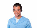 Handsome male nurse with headphones smiling portrait of and looking at you on isolated studio Royalty Free Stock Photos