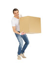 Handsome man with big box picture of Stock Photos