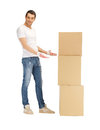 Handsome man with big boxes picture of Stock Photography