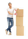 Handsome man with big boxes picture of Stock Image