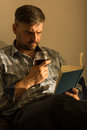 Handsome man with book picture of and glass of wine Royalty Free Stock Photos