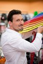Handsome man buying umbrella at supermarket portrait of young guy an Royalty Free Stock Image