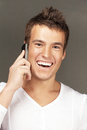 Handsome man calls by telephone Royalty Free Stock Images
