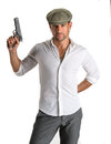 Handsome man in cap with a gun on white background Royalty Free Stock Image