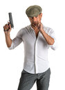 Handsome man in cap with a gun on white background Royalty Free Stock Photo