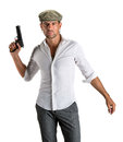 Handsome man in cap with a gun Royalty Free Stock Photo