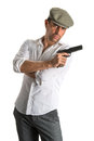 Handsome man in cap with a gun on white background Royalty Free Stock Photos