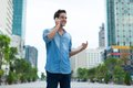 Handsome man cell phone call smile outdoor city Royalty Free Stock Photo