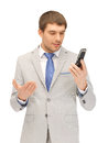 Handsome man with cell phone picture of Stock Photography
