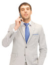 Handsome man with cell phone picture of Royalty Free Stock Images