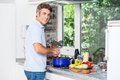 Handsome man cooking at home kitchen smile Royalty Free Stock Photo