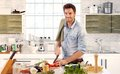Handsome man cooking in kitchen at home Royalty Free Stock Photo