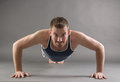 Handsome man doing push ups happy attractive sporty exercises Royalty Free Stock Images