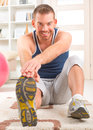Handsome man doing sit ups happy attractive sporty exercises at home Royalty Free Stock Photo