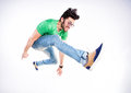 Handsome man dressed casual jumping and smiling dynamic wide shot angle Royalty Free Stock Image