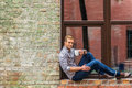 Handsome man drinking coffee outside of office building Royalty Free Stock Photo