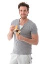 Handsome man eating ice cream smiling Royalty Free Stock Photography