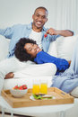 Handsome man feeding his girlfriend with strawberry Royalty Free Stock Photo