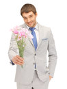 Handsome man with flowers in hand picture of Royalty Free Stock Image