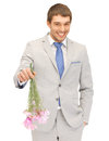 Handsome man with flowers in hand picture of Stock Photo