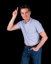 Handsome man hands pointing upwards middle age black background Royalty Free Stock Image
