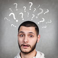 Handsome man has too many questions Royalty Free Stock Photo