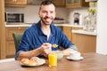 Handsome man having breakfast Royalty Free Stock Photo