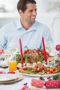 Handsome man having christmas dinner in dinning room Royalty Free Stock Photo