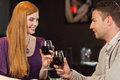 Handsome man having glass of wine with his gorgeous girlfriend men in a classy restaurant Royalty Free Stock Images